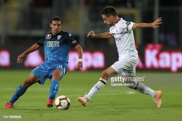 Ismael Bennacer of Empoli FC fights for the ball with Giacomo Bonaventura of AC Milan during the serie A match between Empoli and AC Milan at Stadio...