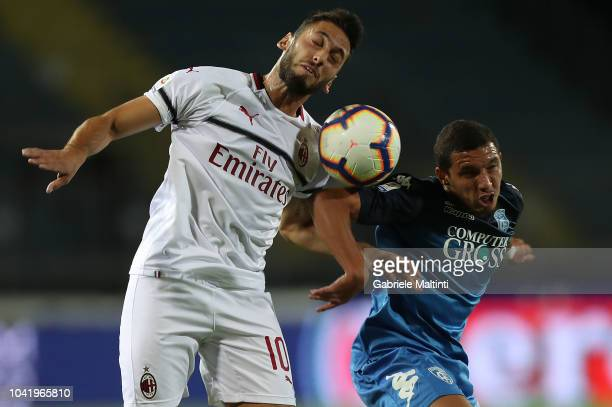 Ismael Bennacer of Empoli FC fights for the ball with Hakan Calhanoglu of AC Milan during the serie A match between Empoli and AC Milan at Stadio...