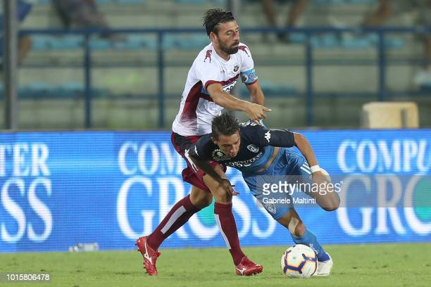 Ismael Bennacer of Empoli FC in action aginst Manuel Iori of Cittadella during the Coppa Italia match between Empoli FC and Cittadella at Stadio...
