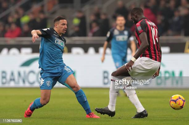 Ismael Bennacer of Empoli FC is challenged by Tiemoue Bakayoko of AC Milan during the Serie A match between AC Milan and Empoli at Stadio Giuseppe...