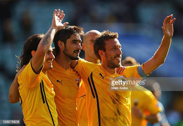 Ismael Blanco of AEK Athens celebrates with his team mates Nikos Lyberopulos and Pantelis Kafes after scoring his team's second goal during the...