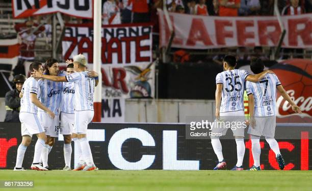 Ismael Blanco of Atletico de Tucuman celebrates with teammates after scoring the second goal of his team during a match between River Plate and...