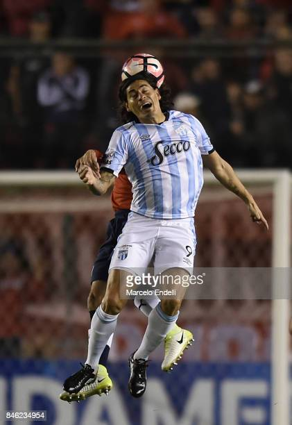 Ismael Blanco of Atletico Tucuman heads the ball during a second leg match between Independiente and Atletico Tucuman as part of round of 16 of Copa...