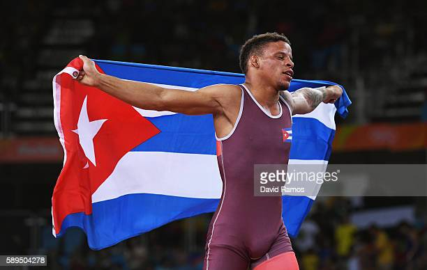 Ismael Borrero Molina of Cuba celebrates after defeating Shinobu Ota of Japan in the Men's GrecoRoman 59 kg Gold Medal match on Day 9 of the Rio 2016...