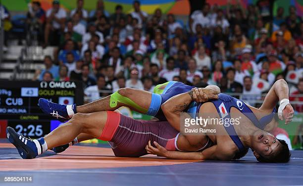 Ismael Borrero Molina of Cuba competes against Shinobu Ota of Japan in the during the Men's GrecoRoman 59 kg Gold Medal match on Day 9 of the Rio...