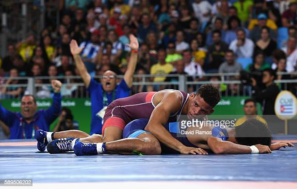 Ismael Borrero Molina of Cuba defeats Shinobu Ota of Japan in the Men's GrecoRoman 59 kg Gold Medal match on Day 9 of the Rio 2016 Olympic Games at...