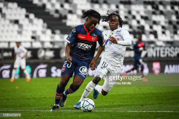 Ismael DOUKOURE of Valenciennes and Arnaud LUSAMBA of Amiens during the Ligue 2 match between Amiens and Valenciennes at Stade de la Licorne on April...