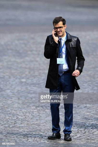Ismael Emelien special advisor of French president Emmanuel Macron talks on the phone on May 14 2017 in Paris at the Arc of Triomphe monument after...