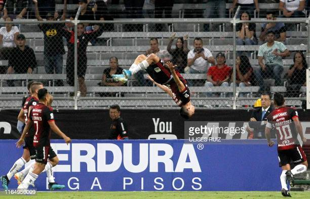 Ismael Govea of Atlas celebrates after scoring a goal during the Mexican Apertura tournament football match between Atlas and America at Jalisco...