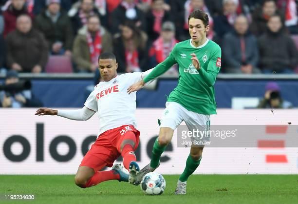 Ismael Jakobs of 1 FC Koeln tackles Benjamin Goller of SV Werder Bremen during the Bundesliga match between 1 FC Koeln and SV Werder Bremen at...