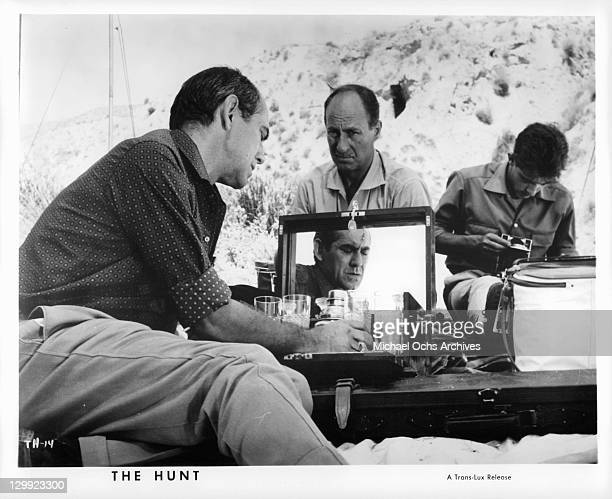 Ismael Merlo makes a drink while Alfredo Mayo watches in a scene from the film 'The Hunt' 1967