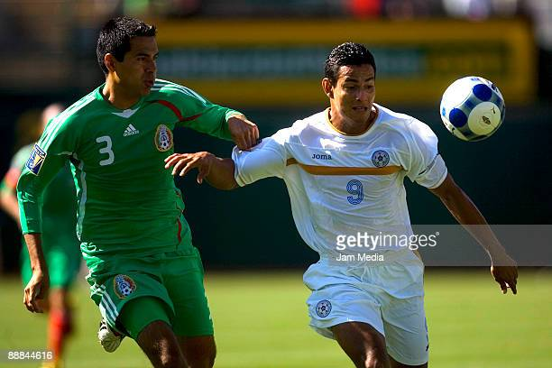 Ismael Rodriguez of Mexico vies for the ball with Wibert Sanchez of Nicaragua during the 2009 Gold Cup game at the Oakland Coliseum Stadium on July...