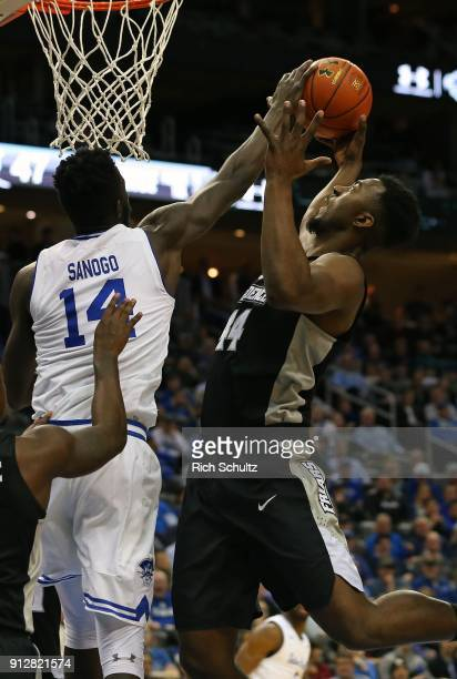 Ismael Sanogo of the Seton Hall Pirates blocks a shot by Isaiah Jackson of the Providence Friars during the second half of a game at Prudential...