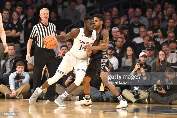 Ismael Sanogo of the Seton Hall Pirates dribbles around Aaron Thompson of the Butler Bulldogs during the quarterfinal round the Big East Men's...