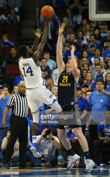 Ismael Sanogo of the Seton Hall Pirates in action against Harry Froling of the Marquette Golden Eagles during a game at Prudential Center on February...