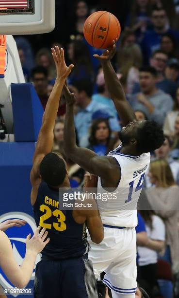 Ismael Sanogo of the Seton Hall Pirates in action against Jamal Cain of the Marquette Golden Eagles during a game at Prudential Center on February 7...