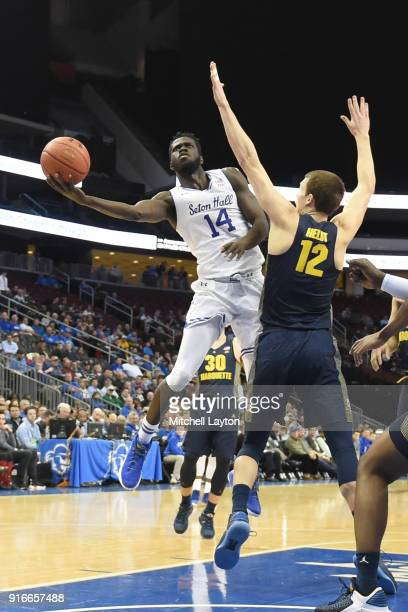 Ismael Sanogo of the Seton Hall Pirates takes a shot around Matt Heldt of the Marquette Golden Eagles during a college basketball game at the...