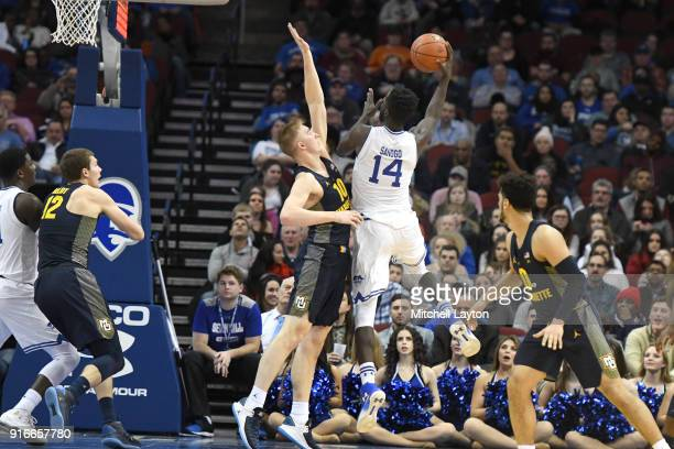 Ismael Sanogo of the Seton Hall Pirates takes a shot over Sam Hauser of the Marquette Golden Eaglesduring a college basketball game at the Prudential...