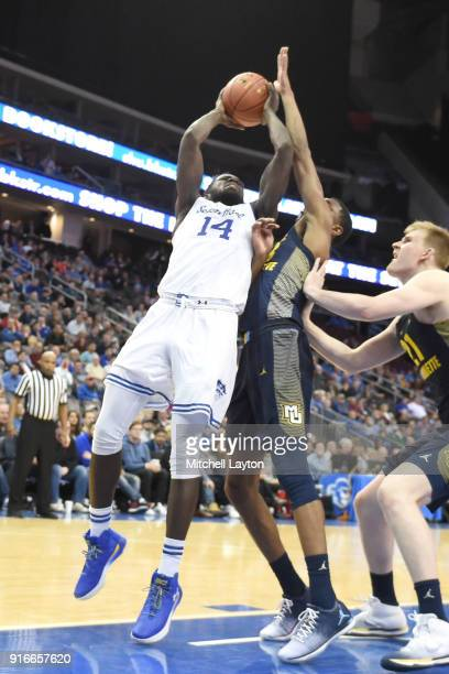 Ismael Sanogo of the Seton Hall Pirates tdrives to the basketduring a college basketball game against the Marquette Golden Eagles at the Prudential...