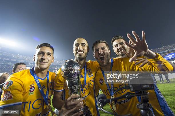 Ismael Sosa Guido Pizarro Andre Gignac and Andy Delort of Tigres pose with the champions trophy after the Final second leg match between Tigres UANL...