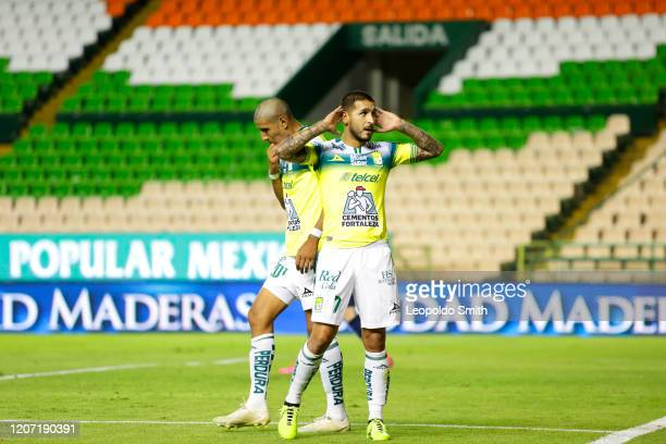 Ismael Sosa of Leon celebrates after scoring the third goal of his team with Armando Leon during the 10th round match between Leon and Pumas UNAM as...