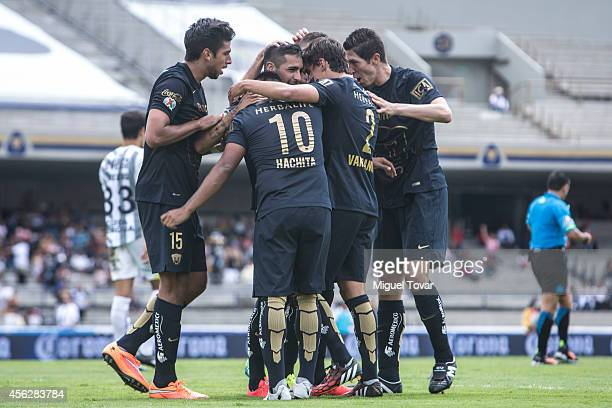Ismael Sosa of Pumas celebrates with his teammates after scoring the opening goal during a match between Pumas UNAM and Chiapas as part of 10th round...