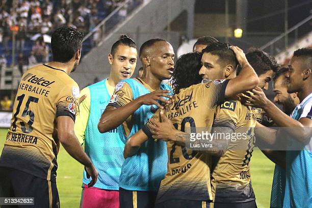 Ismael Sosa of Pumas UNAM celebrates with his teammates after scoring the second goal of his team during a match between Olimpia and Pumas UNAM as...