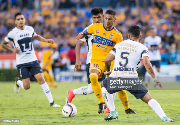Ismael Sosa of Tigres fights for the ball with Alan Mendoza of Pumas during the 5th round match between Tigres and Pumas as part of the Torneo...