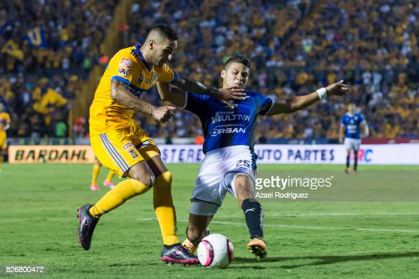 Ismael Sosa of Tigres fights for the ball with Alexis Perez of Queretaro during the 3rd round match between Tigres UANL and Puebla as part of the...
