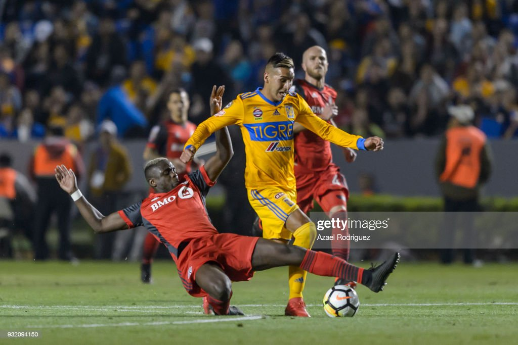 Ismael Sosa of Tigres fights for the ball with Chrys Mavinga of Toronto during the quarterfinals second leg match between Tigres UANL and Toronto FC as part of the CONCACAF Champions League 2018 at Universitario Stadium on March 13, 2018 in Monterrey, Mexico.