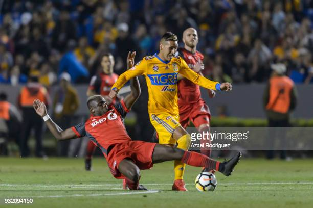 Ismael Sosa of Tigres fights for the ball with Chrys Mavinga of Toronto during the quarterfinals second leg match between Tigres UANL and Toronto FC...