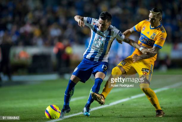 Ismael Sosa of Tigres fights for the ball with Emmanuel Garcia of Pachuca during the 4th round match between Tigres UANL and Pachuca as part of the...