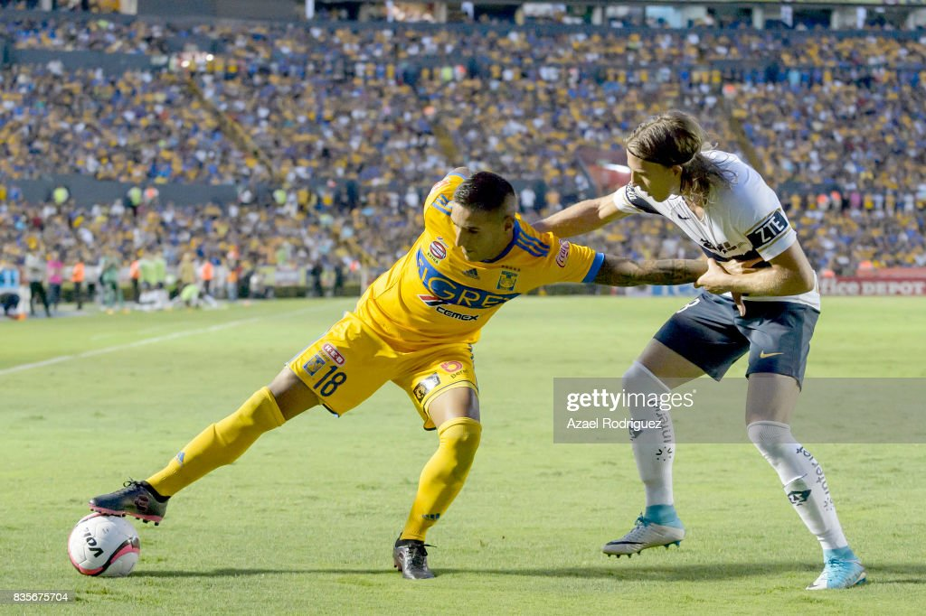 Ismael Sosa of Tigres fights for the ball with Jose Garcia of Pumas during the 5th round match between Tigres and Pumas as part of the Torneo Apertura 2017 Liga MX at Universitario Stadium on August 19, 2017 in Monterrey, Mexico.