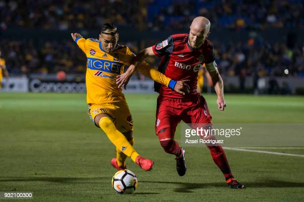 Ismael Sosa of Tigres fights for the ball with Michael Bradley of Toronto during the quarterfinals second leg match between Tigres UANL and Toronto...