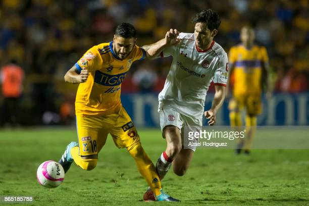 Ismael Sosa of Tigres fights for the ball with Santiago Garcia of Toluca during the 14th round match between Tigres UANL and Toluca as part of the...