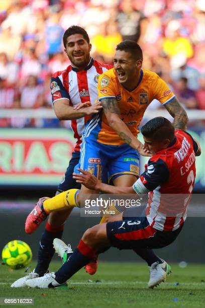 Ismael Sosa of Tigres struggles for the ball with Carlos Salcido and Jair Pereira of Chivas during the Final second leg match between Chivas and...