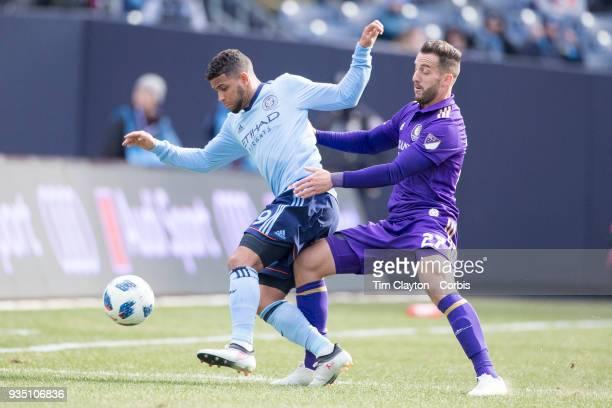 Ismael Tajouri of New York City challenged by RJ Allen of Orlando City during the New York City FC Vs Orlando City SC regular season MLS game at...
