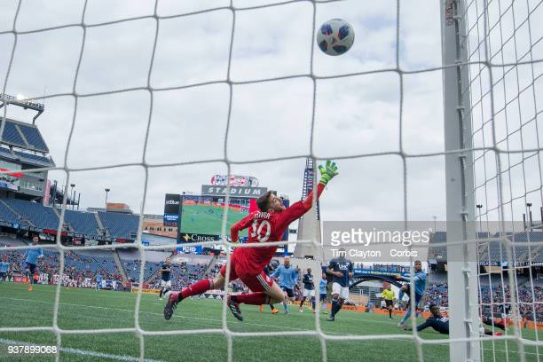 Ismael TajouriShradi of New York City scores the second of his two goals beating goalkeeper Matt Turner of New England Revolution during the 22 draw...