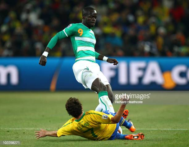 Ismael Tiote of Ivory Coast tackles Elano of Brazil which sees Elano stretchered off during the 2010 FIFA World Cup South Africa Group G match...