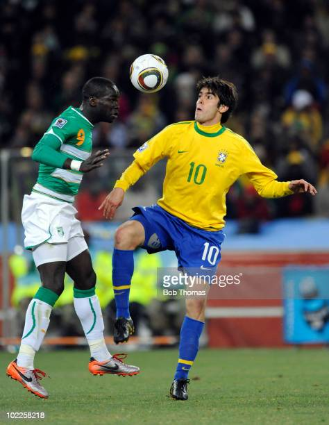 Ismael Tiote of the Ivory Coast heads the ball with Kaka of Brazil during the 2010 FIFA World Cup South Africa Group G match between Brazil and Ivory...