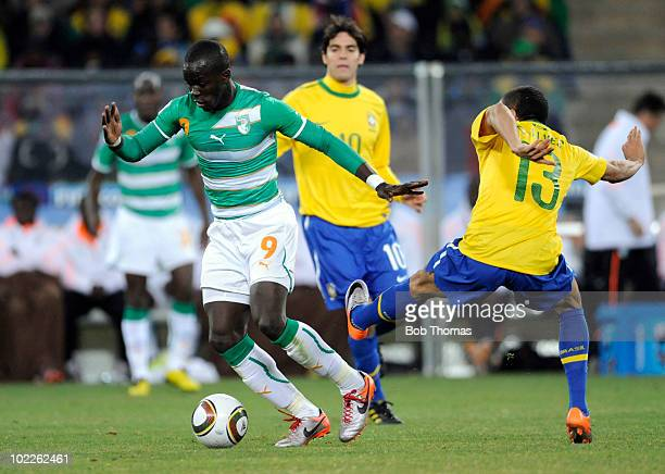 Ismael Tiote of the Ivory Coast is tackled by Dani Alves of Brazil during the 2010 FIFA World Cup South Africa Group G match between Brazil and Ivory...