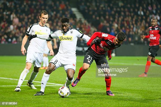 Ismael Traore of Angers and Ludovic Blas of Guingamp during the Ligue 1 match between Guingamp and Angers at Stade du Roudourou on October 29 2016 in...
