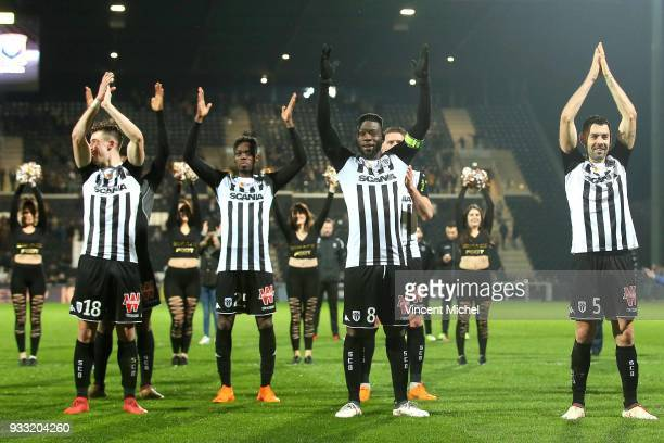 Ismael Traore of Angers celebrates with their fans at the end of the match during the Ligue 1 match between Angers SCO and SM Caen at Stade Raymond...