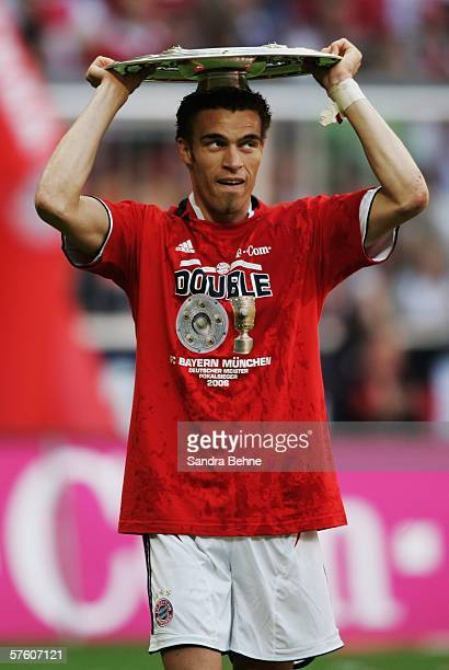 Ismael Valerien of Bayern Munich celebrates with the trophy winning the championchips of the Bundesliga at the Allianz Arena on May 13 2006 in Munich...