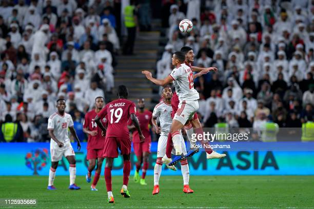 Ismail Ahmed Mohamed of the UAE clashes with Karim Boudiaf of Qatar during the AFC Asian Cup semi final match between Qatar and United Arab Emirates...