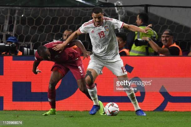 Ismail Ahmed Mohamed of UAE and Abdelkarim Hassan of Qatar compete for the ball during the AFC Asian Cup semi final match between Qatar and United...