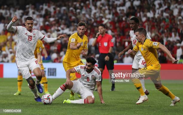 Ismail Ahmed Mohamed of United Arab Emirates and Majed Hassan Ahmad of United Arab Emirates battle for posession with Australia during the AFC Asian...