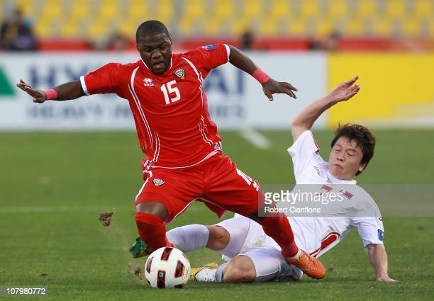 Ismail Al Hammadi of the UAE is tackled by Ryang Yong Gi of DPR Korea during the AFC Asian Cup Group D match between DPR Korea and United Arab...