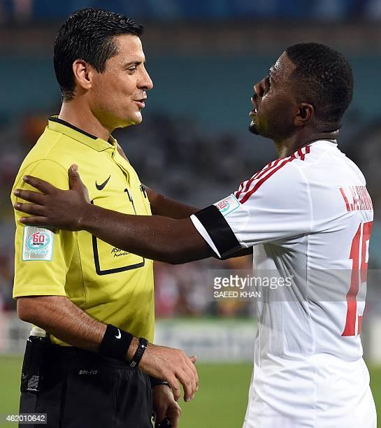 Ismail Al Hammadi of the United Arab Emirates talks to referee Alireza Faghani of Iran during the quarterfinal football match between Japan and UAE...