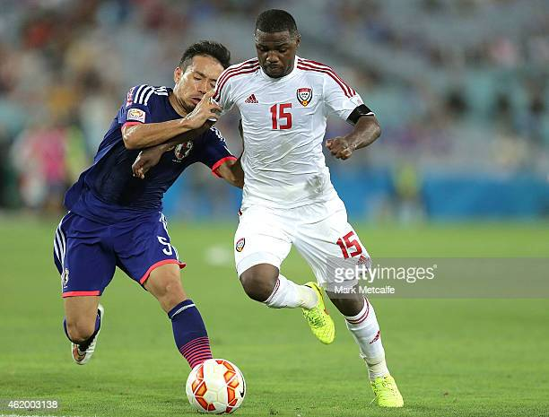 Ismail Al of the United Arab Emirates competes with Yuto Nagatomo of Japan during the 2015 Asian Cup Quarter Final match between Japan and the United...